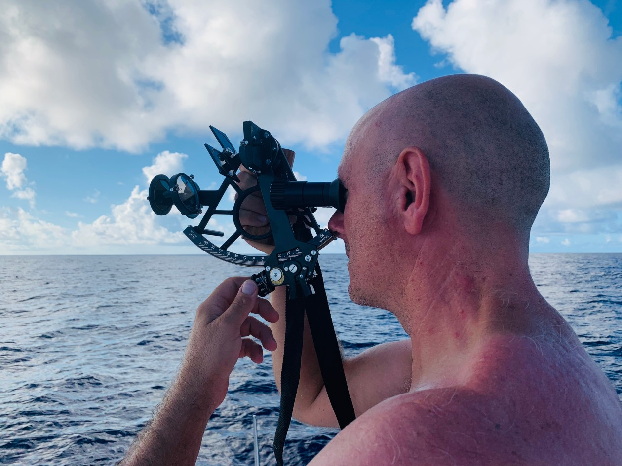 Taking a sight with the sextant during South Atlantic ocean crossing