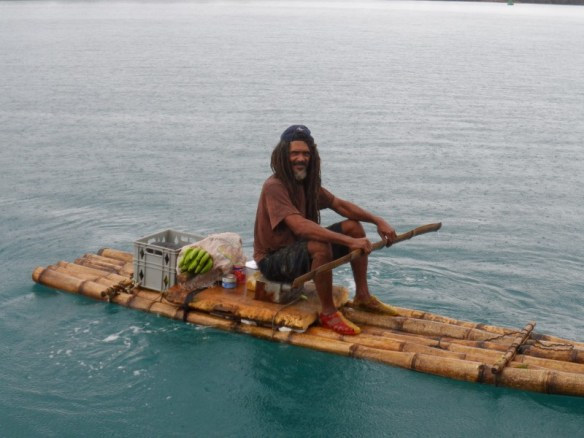 Clive comes by on his homemade bamboo raft to trade shells for food. He lives in the mangroves near our anchorage with his 13 dogs.