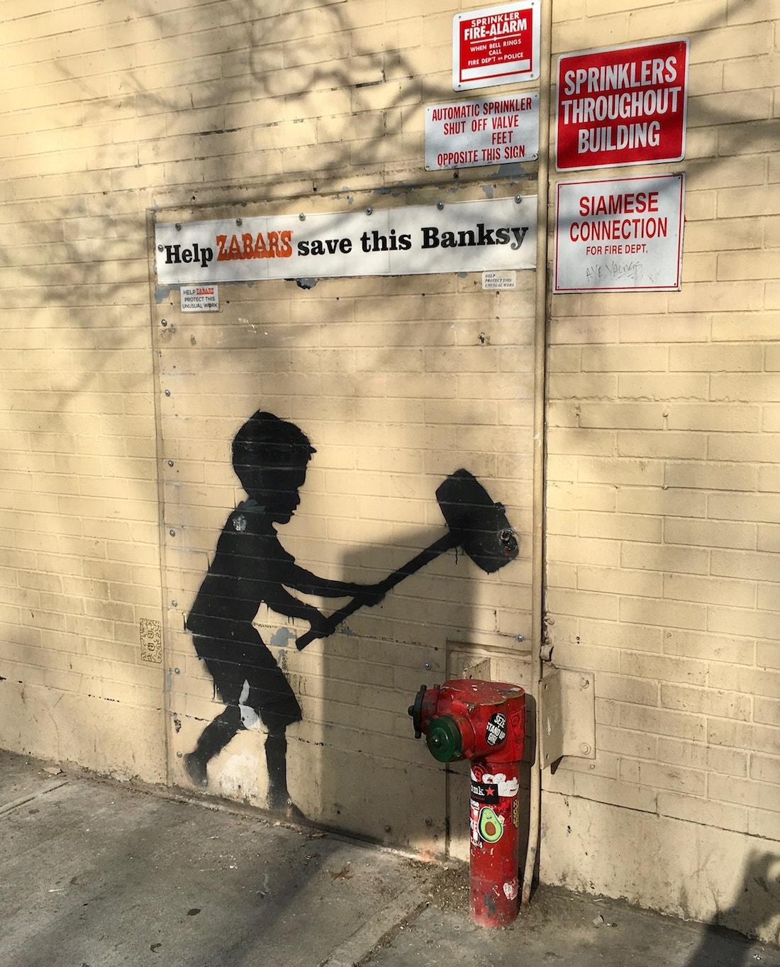 Banksy Hammer Boy NYC