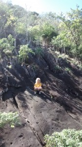 Simon climbed this face of volcanic rock beside the trail. He hypothesized that the divots in the rock were caused by popped air bubbles in the lava. Sounded like a good explanation to me.