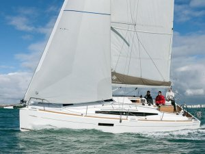 A modern dual purpose boat, the Jeanneau 349. With it's lazy jacks/built-in mainsail cover, non-overlapping furling jib and asymmetric kits on a short sprit, what's not to like?