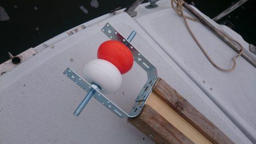 Deux petits flotteurs sur un axe pour le roulement