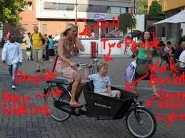 Dutch mom cycling on bakfiets