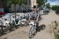 Floris on a white bike in Copenhagen