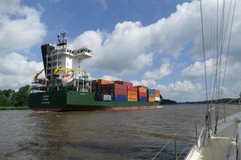 Cargo ships pass us on the Noord- Ostseekanal