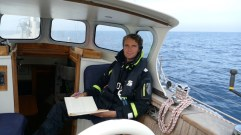 Updating our logbook in a gentle Atlantic Ocean