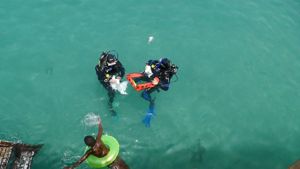 Divers prepare to clean up