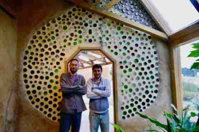 Francesco and Joaquin pose at the bottle wall