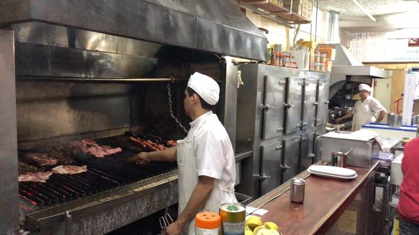 Large steaks on the grill in a parilla restaurant