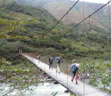 Suspension bridge over a wild river