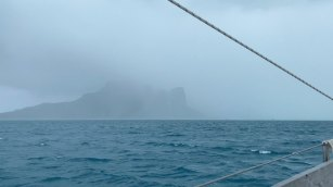 Maupiti disappears in the rain clouds