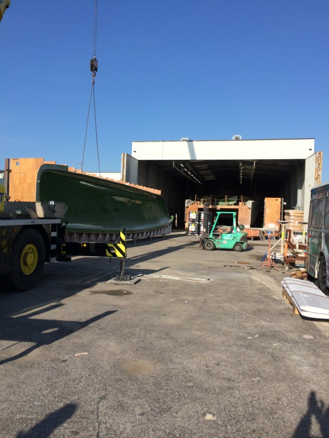 Crane lifting the hull molds out of the shed. One the molds are out, Wildling will move to a different shed to continue the furniture fitout. The deck and roof mold will then be taken inside this shed so the deck section can be manufactured