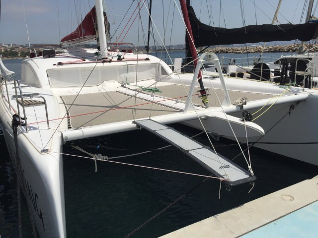 Our new carbon fiber pasaerelle and attachment point on the crossbeam. We use the spinnaker halyard to hold it up.
