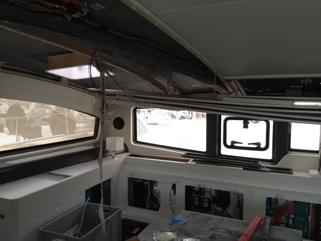 We had to pull the ceiling lining out to install the genoa sheet lead pad-eyes and to run power cables