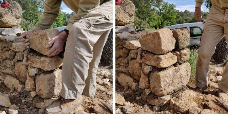 La mise en place des pierres pour recréer les arrêtes du muret.