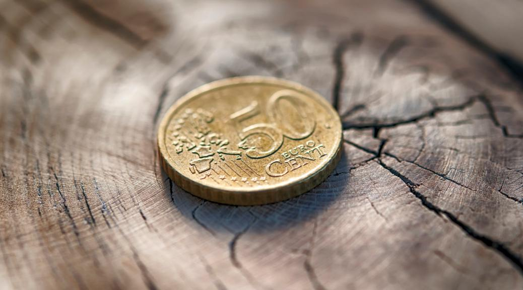 euro coin on wood table