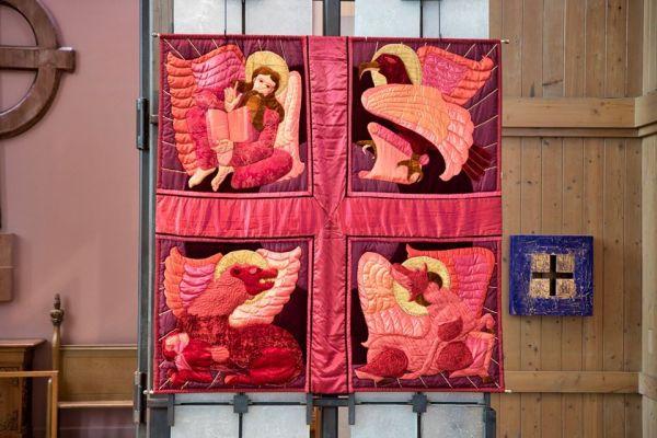 The banner hung on the reredos