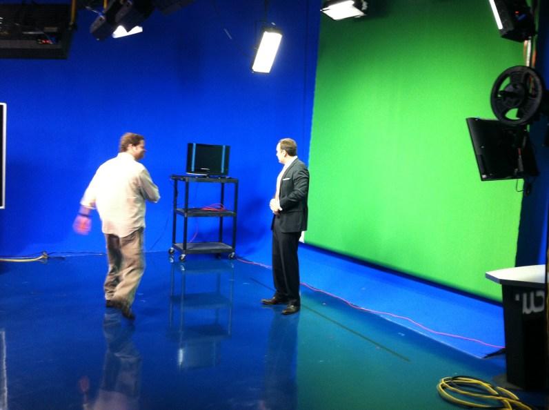 Zach Daniel preparing for a segment with his camera man.
