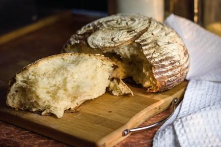 Broken bread on a wooden board. Volcano bread
