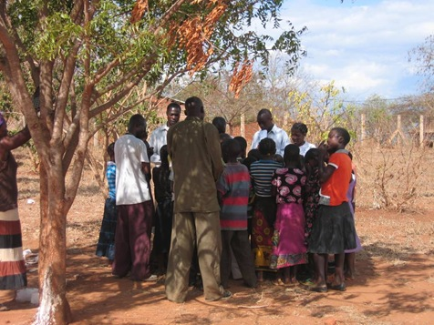 small group time the Bible school students teaching the children a memory verse