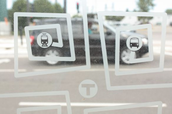A close look at the design in the shelter glass. Not only decorative and promotional, the designs reduce the chance of pedestrians walking into the shelter glass.