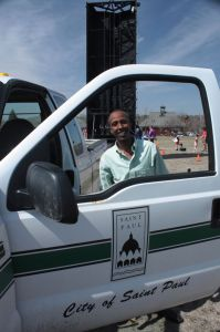 Askar poses with the Parks and Rec truck.