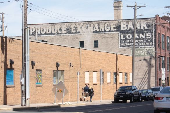 The wall ad is a reminder of the Produce Exchange Bank which was constructed in 1915. The bank was built to serve a sizeable city market nearby.
