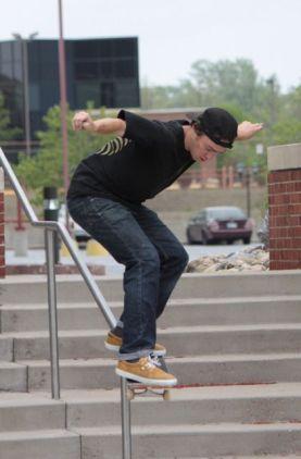 Cruising down the railing.