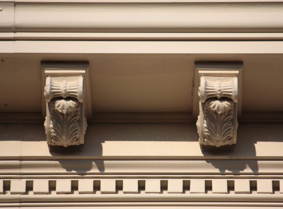 The elaborate modillions and dentils line the top of the building.