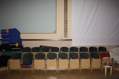 The auditorium retains the original chairs used during Masonic meetings.