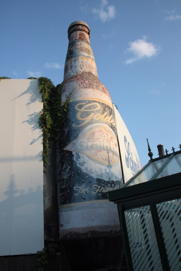 The peeling and fading Grain Belt Beer bottle is on the corner of West Seventh and Jefferson.