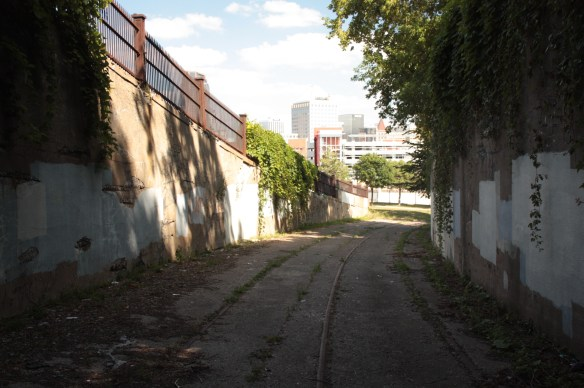 Standing at the sealed entrance of the Selby Hill Tunnel and looking east at downtown.