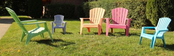Bright pastel colored Adirondack chairs in front of Edgcumbe Presbyterian Church, just west of the high school.