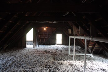 The thick attic insulation will reduce energy bills.