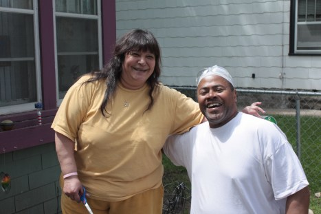 Erma and Allen in front of their Charles Avenue home.