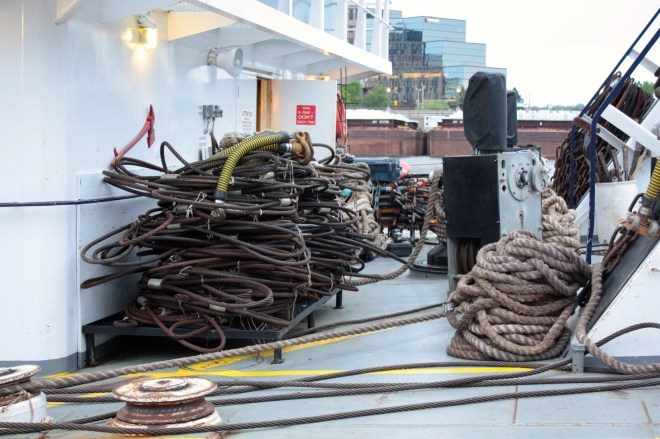 Cables and lines are ready for crew members to use when they attach barges.