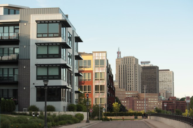 The residential complexes, built since 2004, look fine with their clean, modern lines, but too closely resemble many of the newer condo projects in Minneapolis' trendy North Loop.