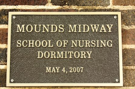 The plaque recognizing the history of the former Festival House as a dorm for nursing students.