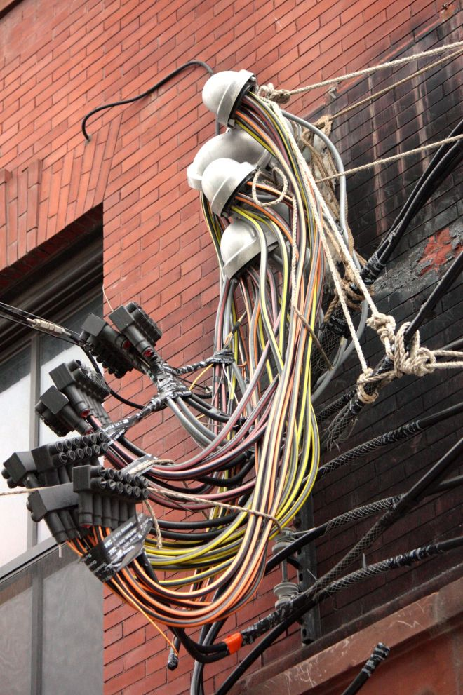 Rope and tape on these cables-I'm doubtful they meet City codes. Market House Condos, 289 East 5th Street.