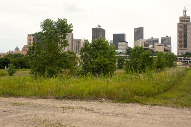 Just south of the Mississippi River and across from Downtown is a large piece of undeveloped land.