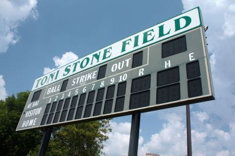 The scoreboard towers above the left-center field outfield fence.