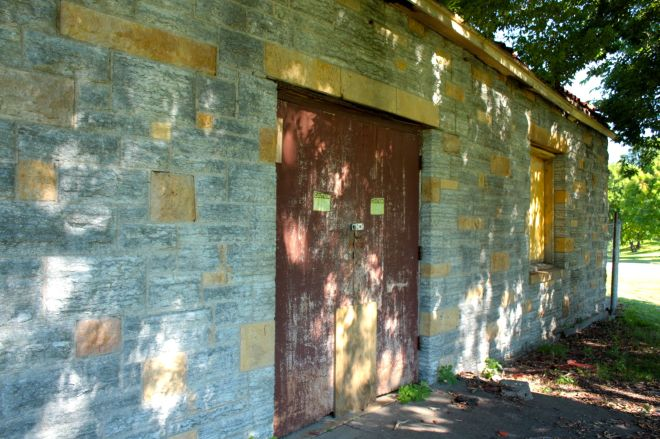 Windows and the doors of the bath house are covered in plywood to keep man, beast and Minnesota's weather out.
