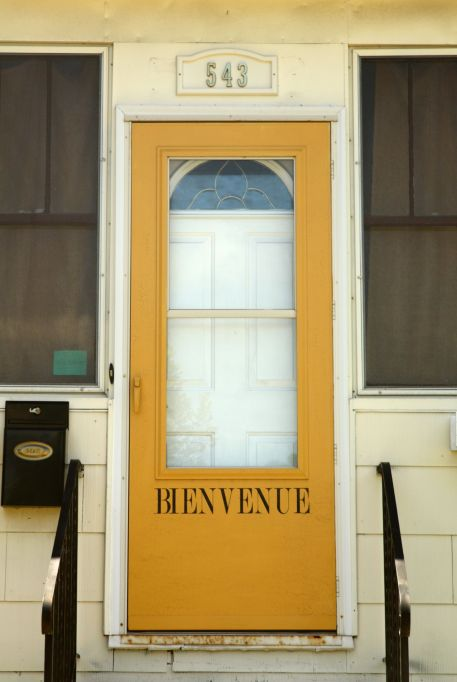 This goldenrod-color door, with its French greeting, is a 543 Smith Avenue South, at George Street.