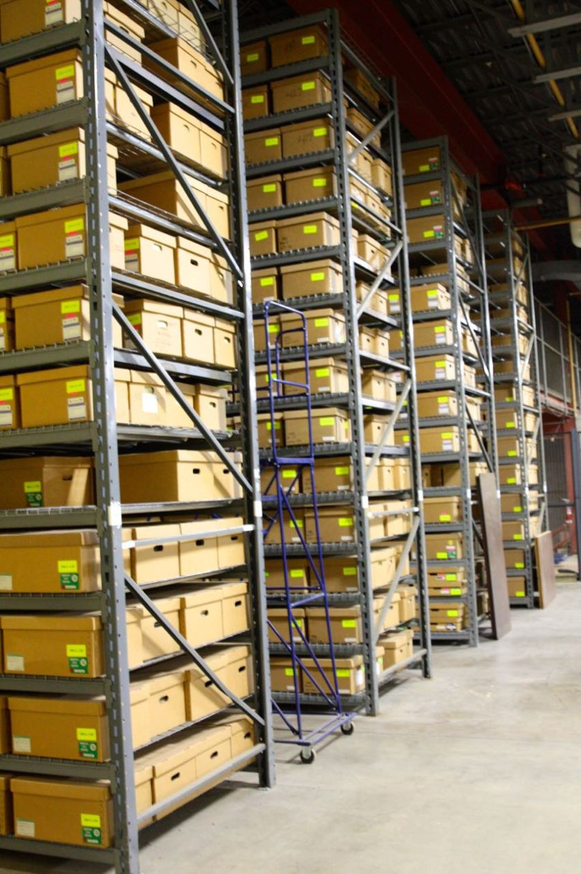 These boxes on 18 foot high shelves contain judicial records and manuscripts. The Records Center has been getting these boxes since the History Center storage reached capacity.