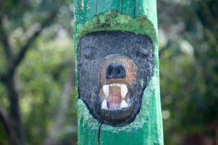 The intricate detail of the objects on the totem pole are revealed with close look.