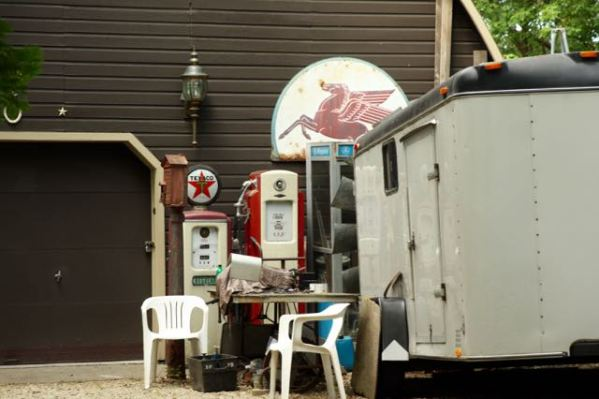Interesting artifacts outside the garage at 361 Burlington include a phone booth, two antique gas pumps and a fire department call box.