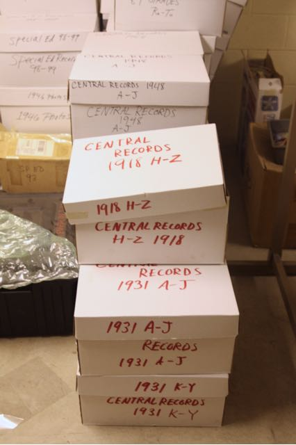 Decades worth of records, some nearly as old as the building, are stored on the floor of an old locker room.