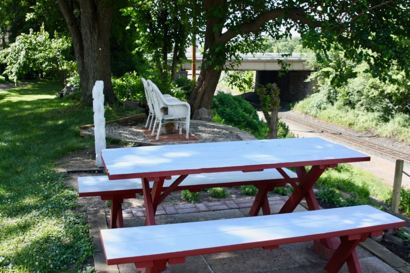 The picnic table and chairs on a couple of the places people can sit and enjoy the outdoors.
