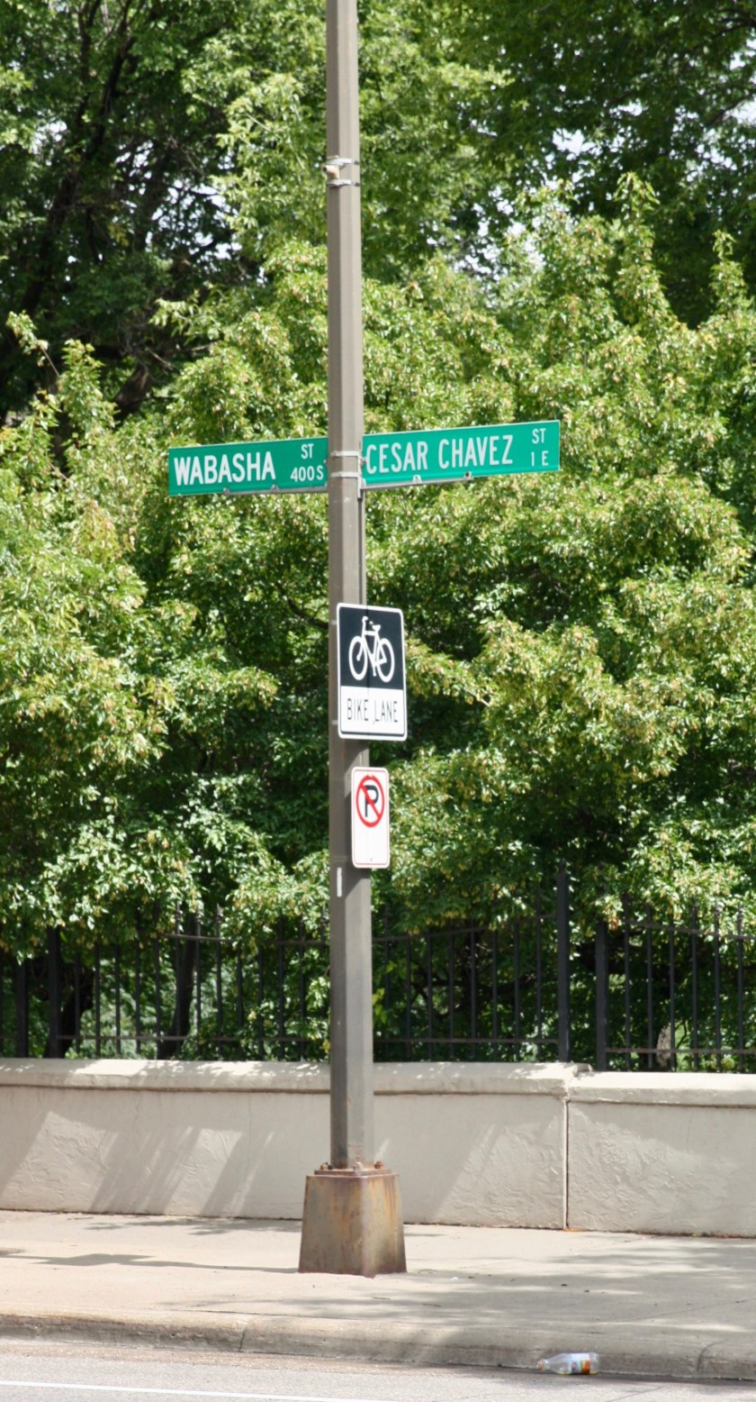 Street signs pointing out the change from Wabasha to Cesar Chavez Street.)
