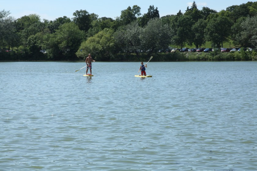 A handful of stand up paddle boarders meandered around the lake on this nice day.
